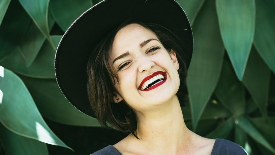 Lady-smiling-with-teeth-about-dental-care-in-Australia