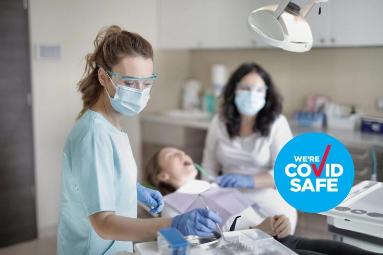 female-dentist-treating-her-patient-3881325-1-scaled